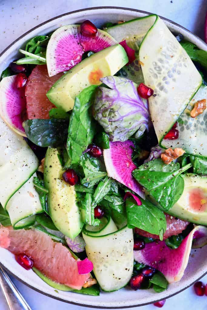 Close up overhead of citrus avocado salad with watermelon radish