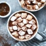Overhead of salted caramel maca hot cocoa with vegan marshmallows with shaved dark chocolate
