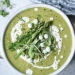 Overhead of asparagus soup with asparagus and peas