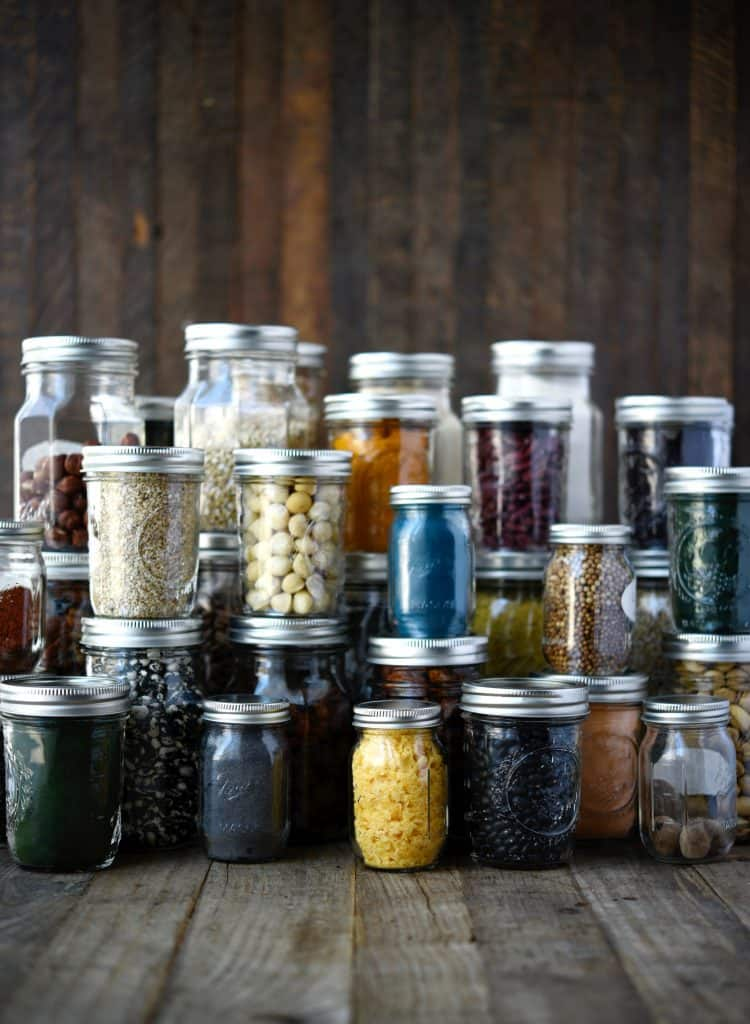 Pantry items in small glass jars to reduce plastic consumption