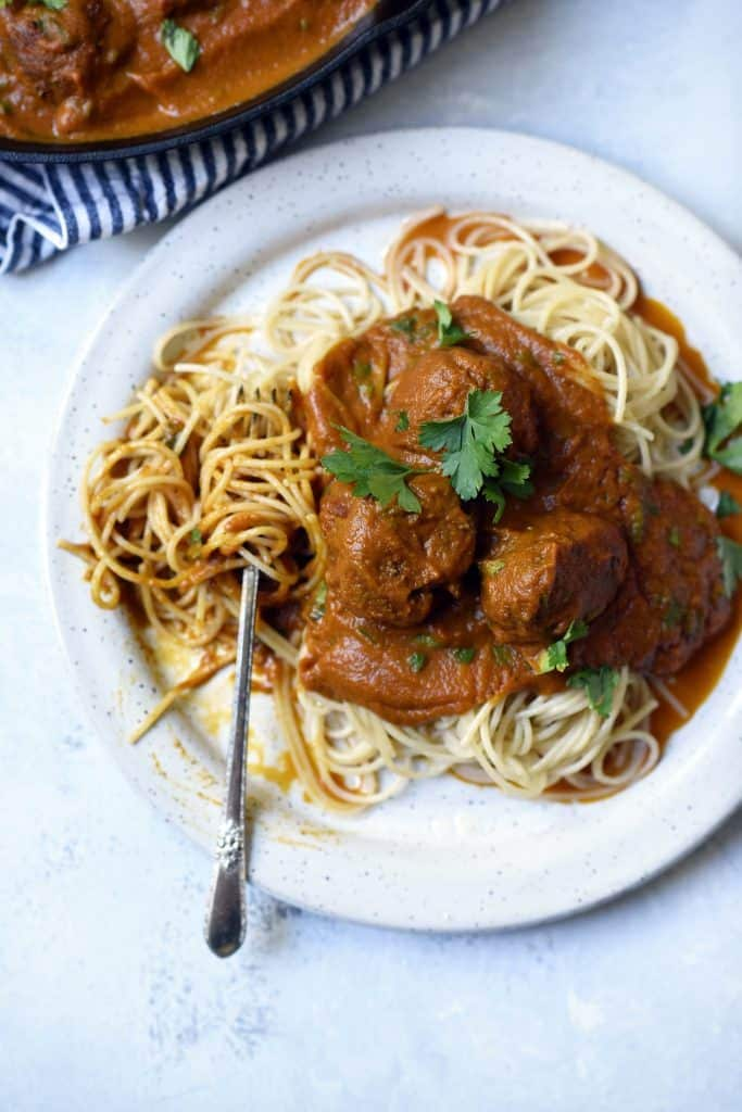 Overhead of vegan juice pulp meatballs and spaghetti on a white plate