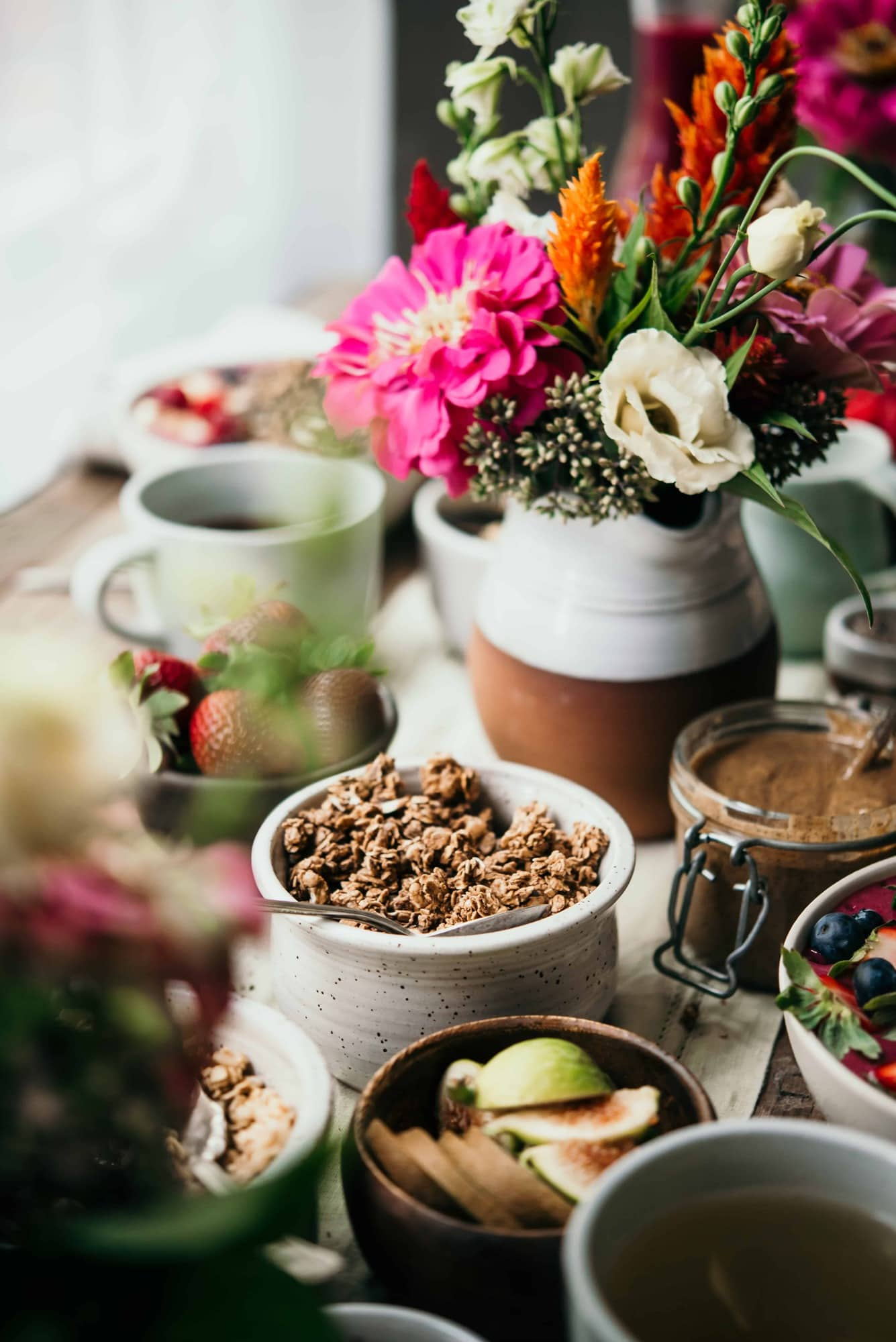 Side view of breakfast tablescape with granola