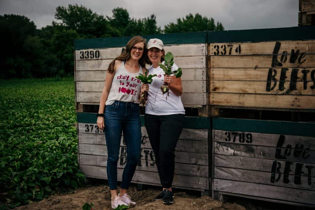 Lexi and Beth in front of the Love Beets crates at their farm in New York