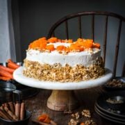Front view of carrot cake on a cake stand.