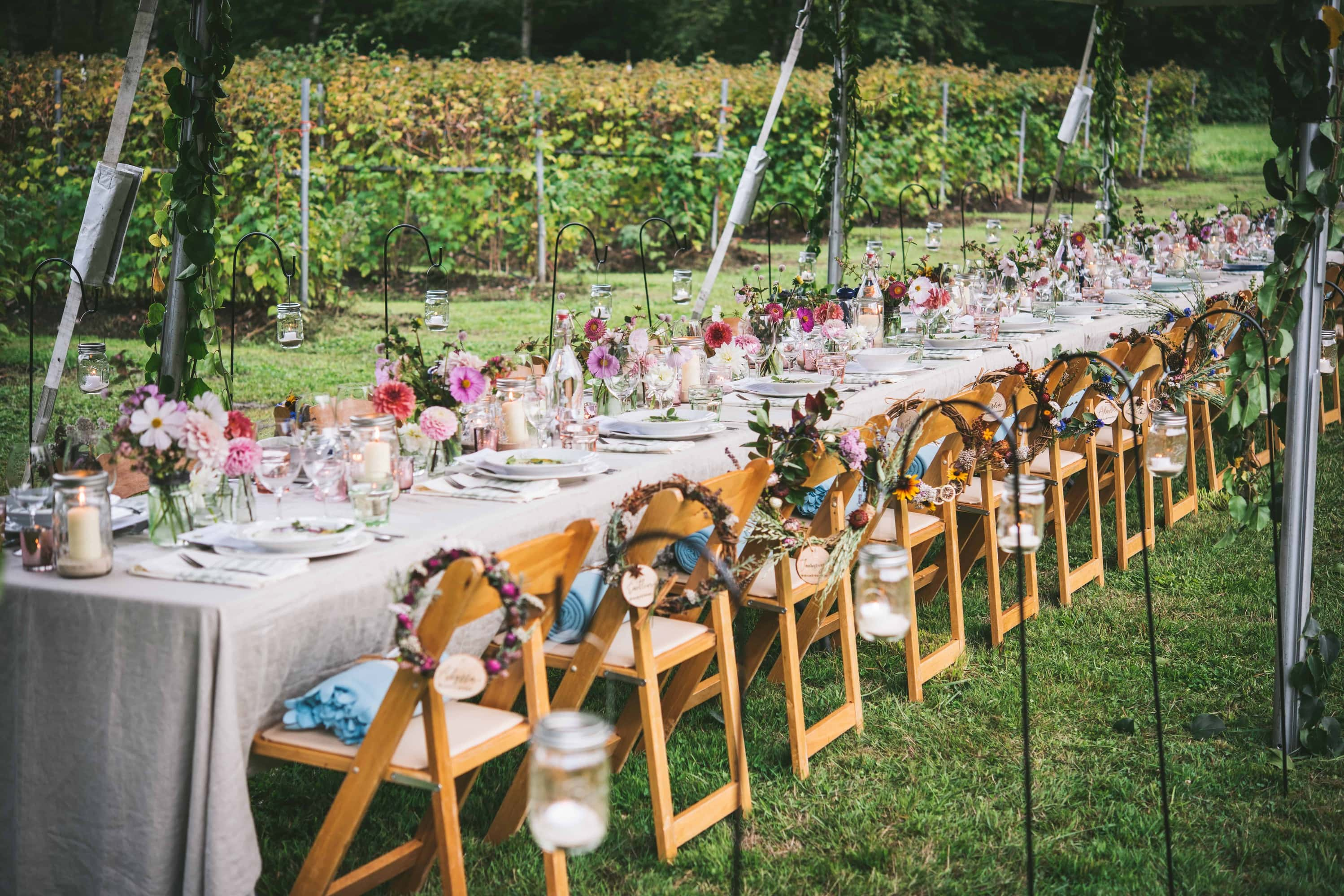 Landscape view of a long farm table set for dinner