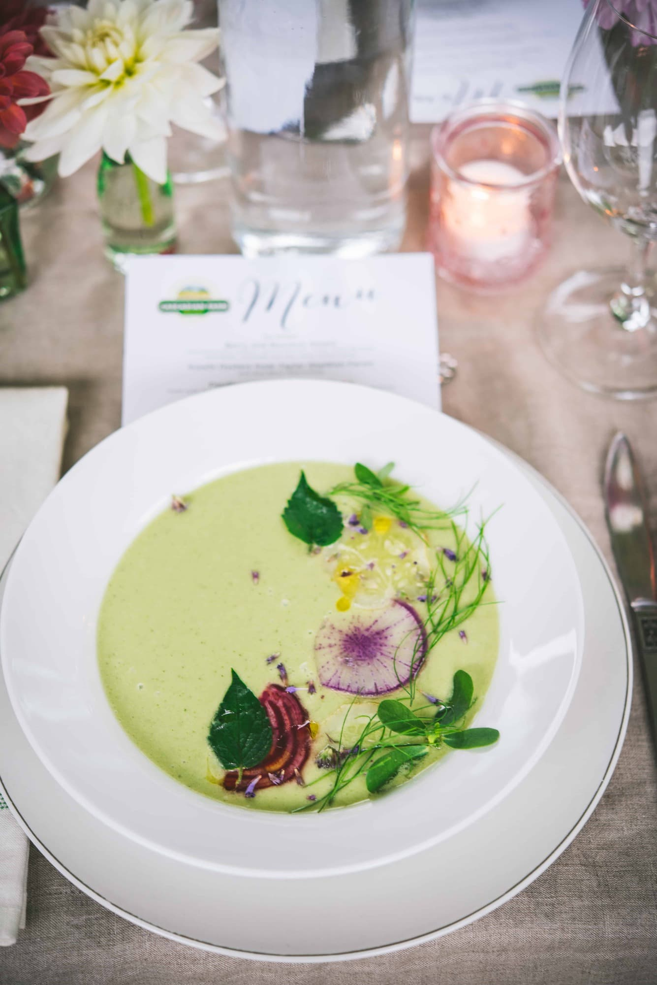 45 Degree angle of a light green appetizer soup with flowers at Cascadian Farms