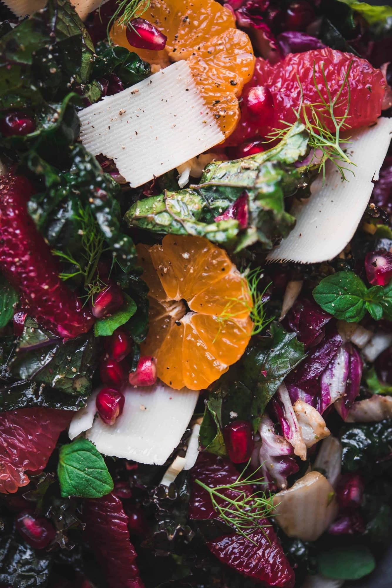 Close up macro shot of kale and citrus salad with mandarins, grapefruit, blood orange and parmesan