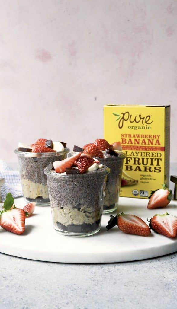 Side view of banana strawberry overnight oats and chia pudding topped with fresh strawberries