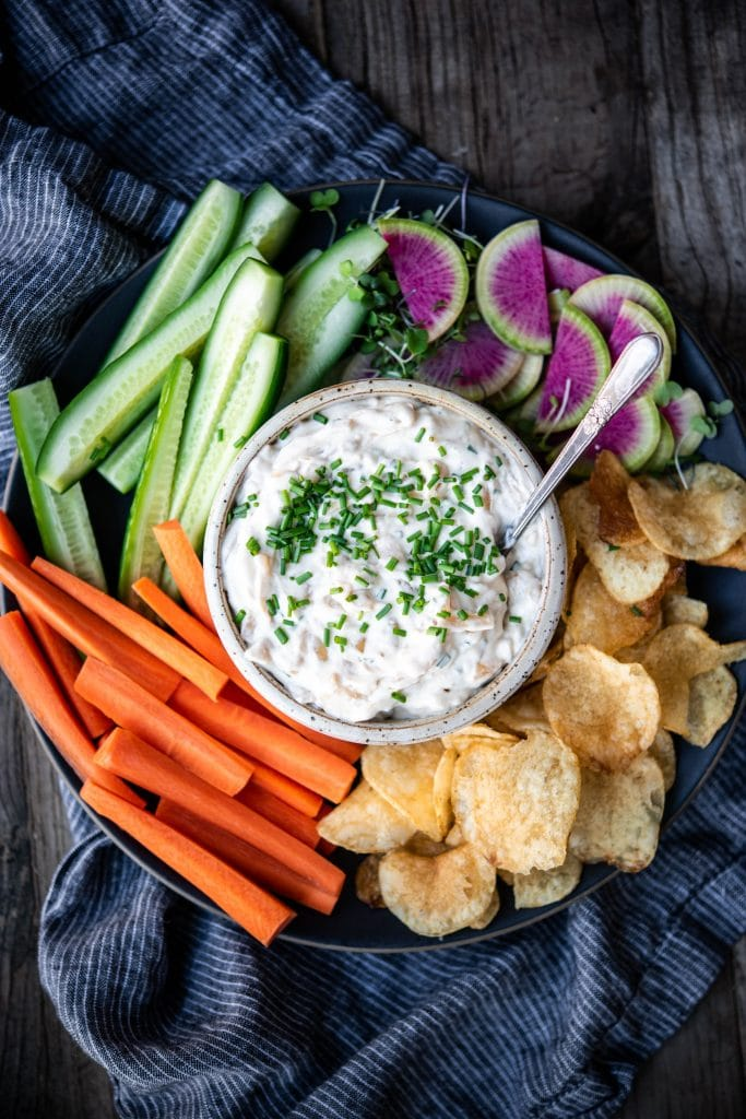 Close up overhead of vegan caramelized onion dip with vegetables