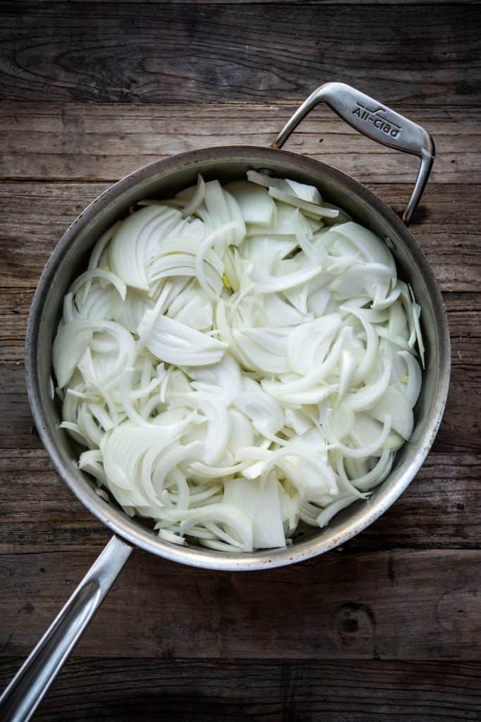 Sliced onions in a pan