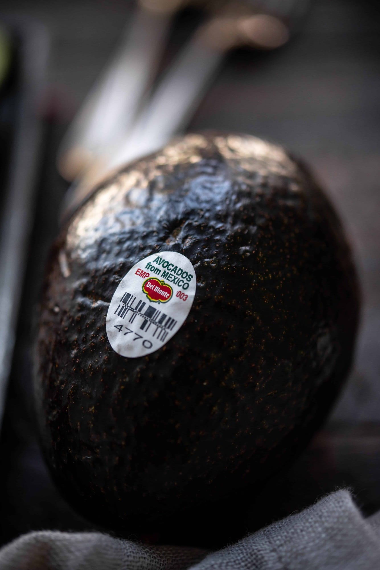 Close up view of Del Monte Fresh Avocado with produce sticker