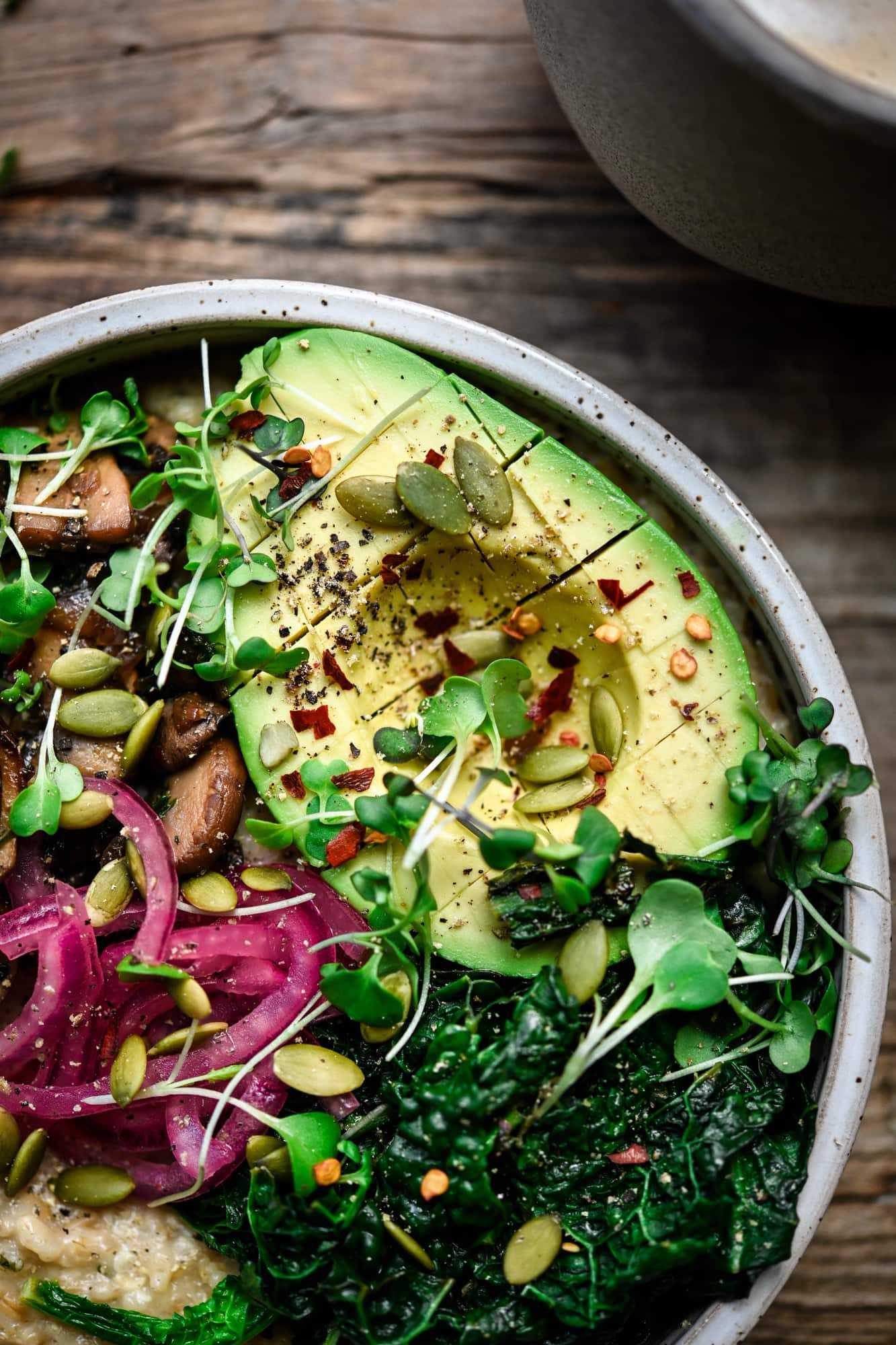 Close up view of vegan avocado in a bowl of savory oatmeal