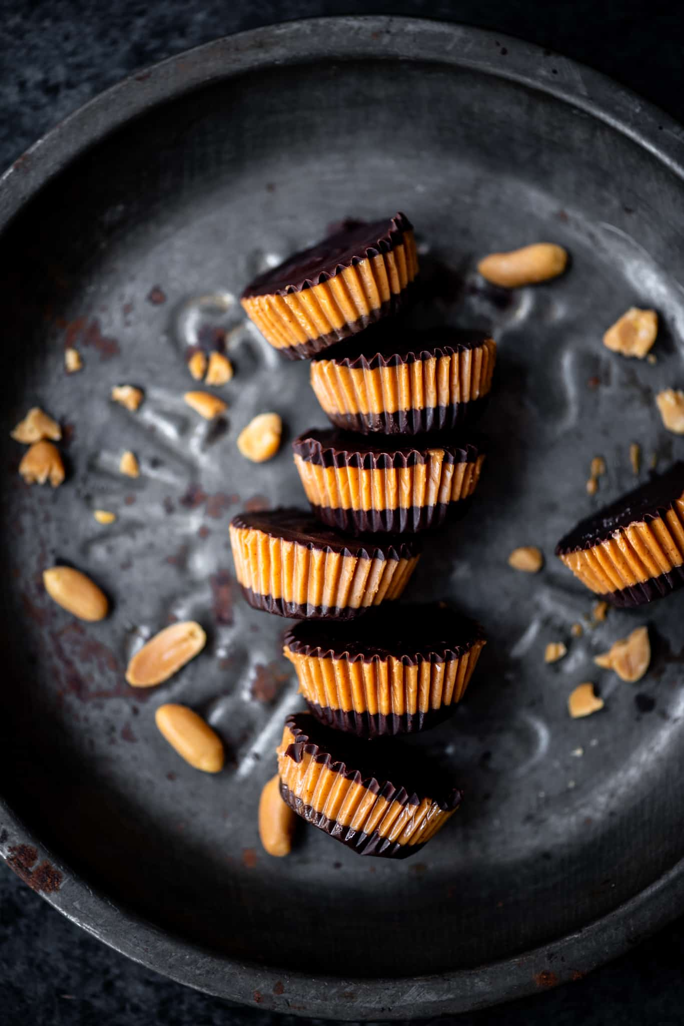 Overhead of vegan peanut butter cups on an antique tray