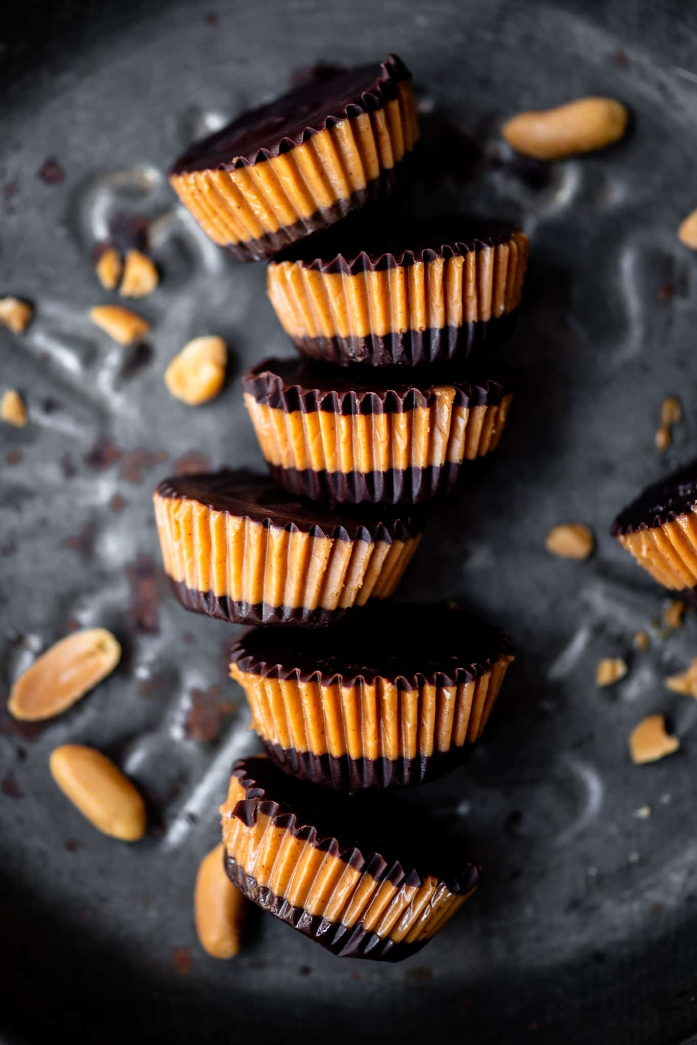 Close up Overhead of vegan peanut butter cups on an antique tray