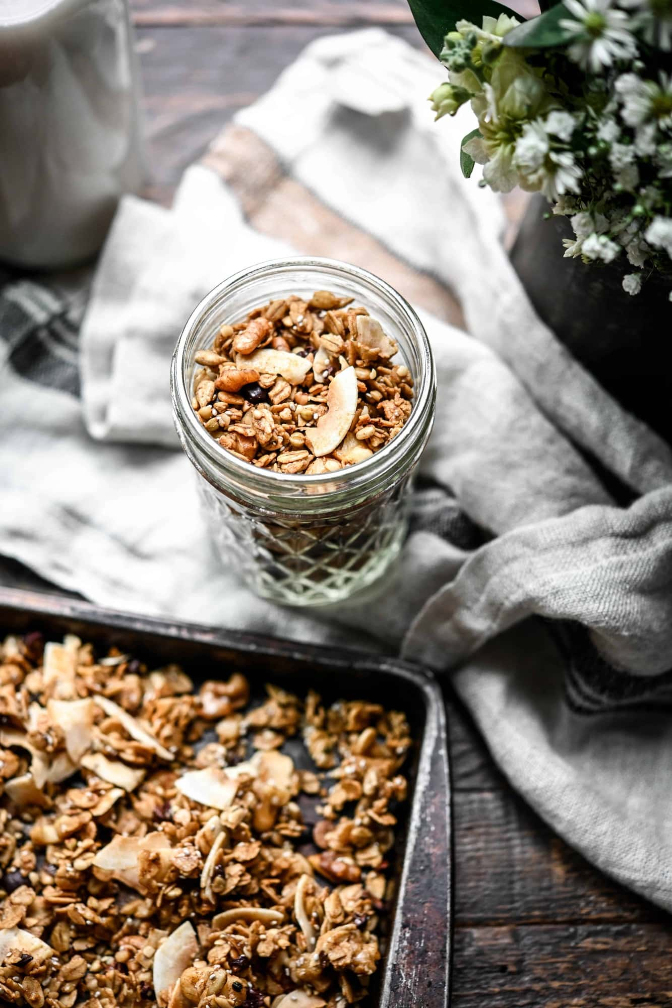 Overhead view of small glass jar filled with gluten free caramel granola