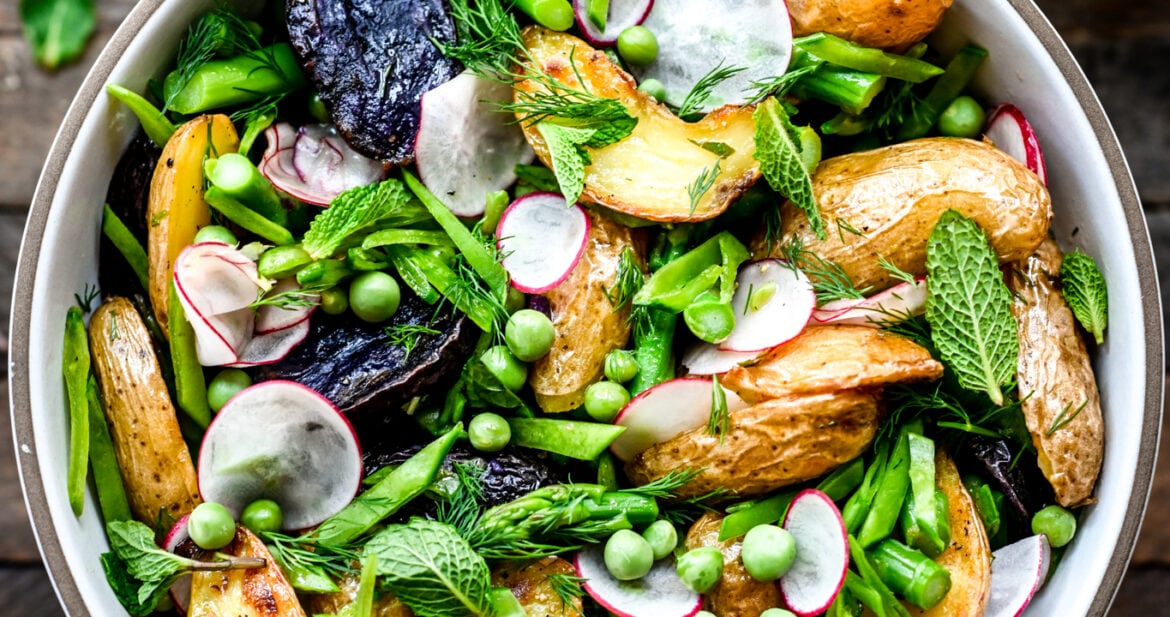 Overhead view of Spring Potato Salad in white bowl