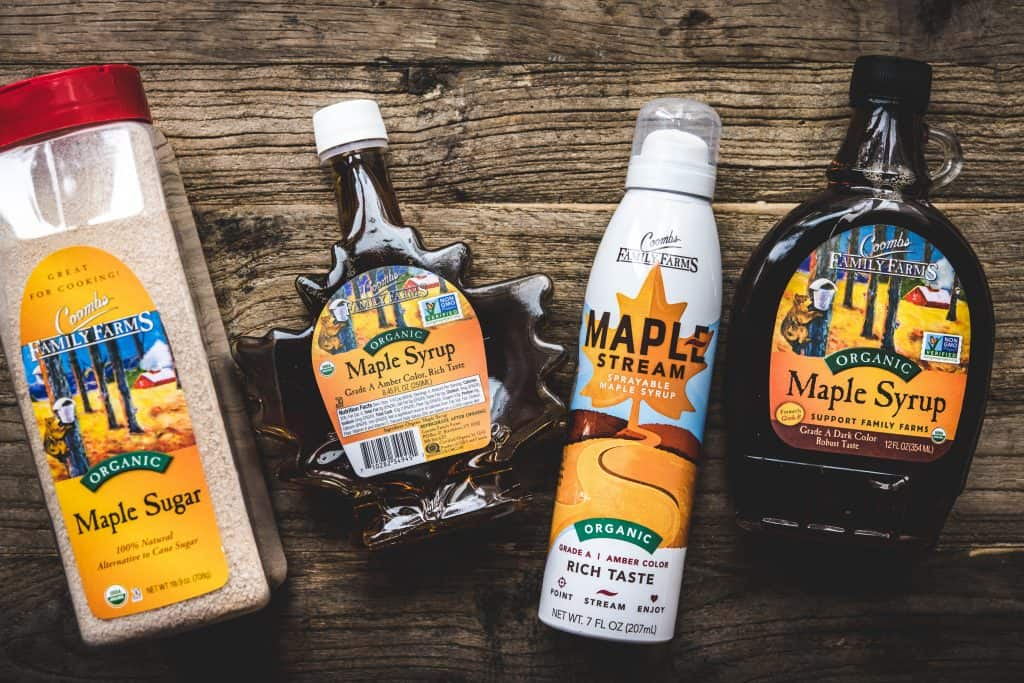 Overhead view of Coombs Family Farms maple syrup products on wood table