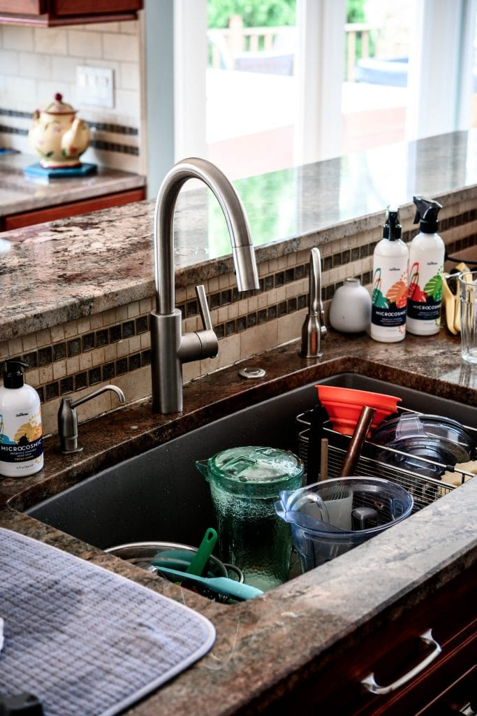 Side view of very messy kitchen sink