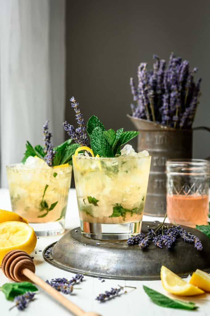 Side view of lemon lavender mint julep on white table