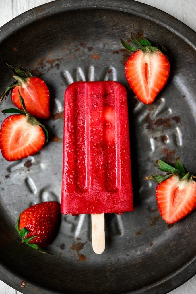 Overhead view of strawberry beet chia popsicle on a rustic aluminum pan