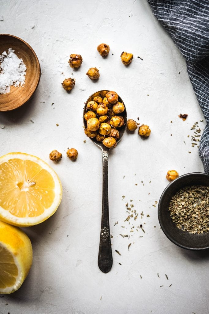 Overhead view of crispy za'atar roasted chickpeas in a white bowl