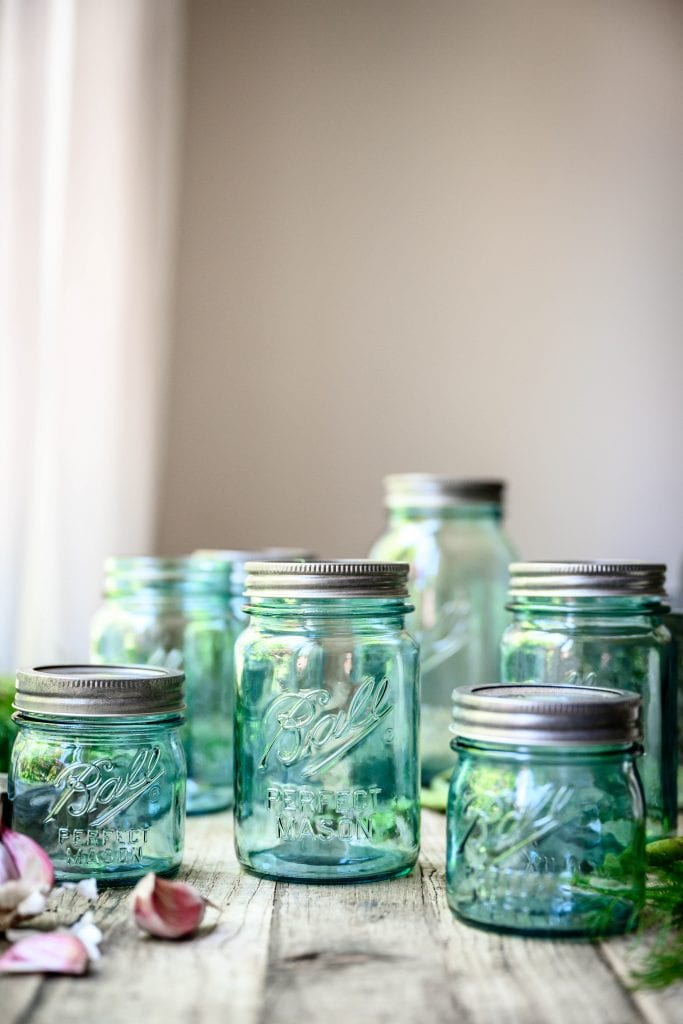 Side view of blue vintage Ball jars on a wood table