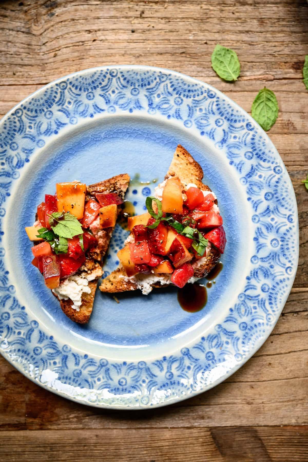 Summer bruschetta on a blue plate