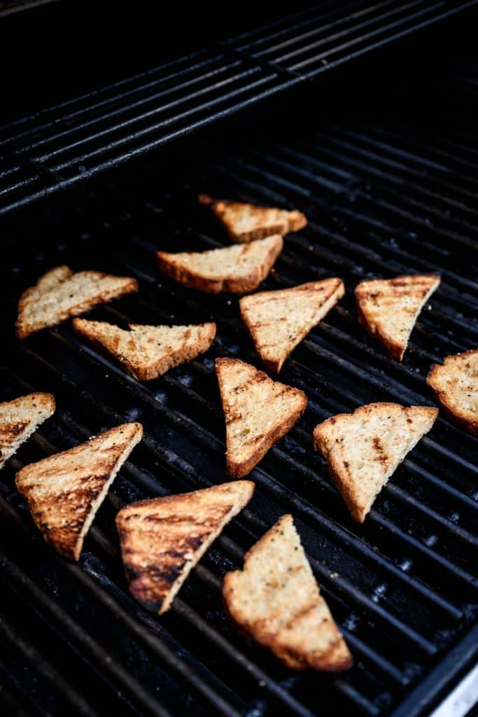Slices of bread on a grill