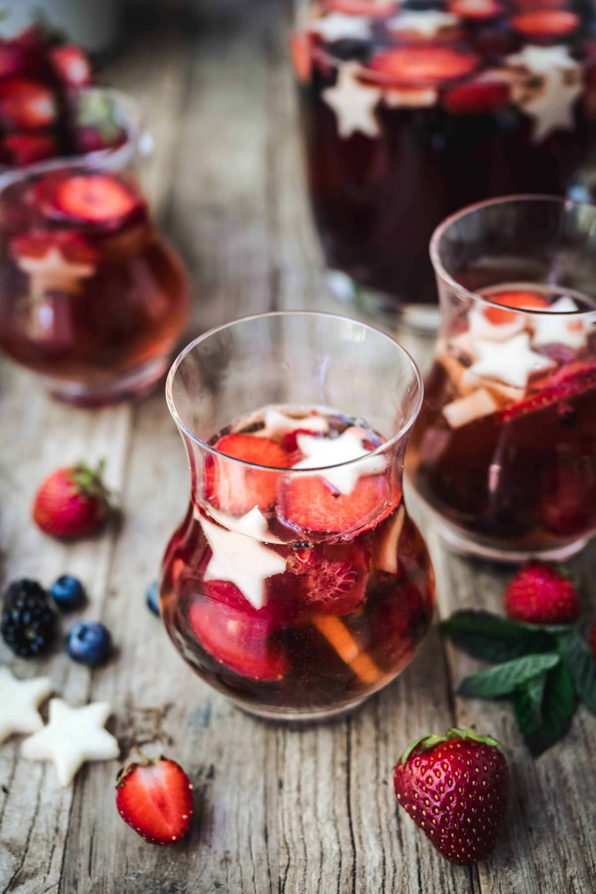 45 degree angle of red white and blue sangria with berries in glasses