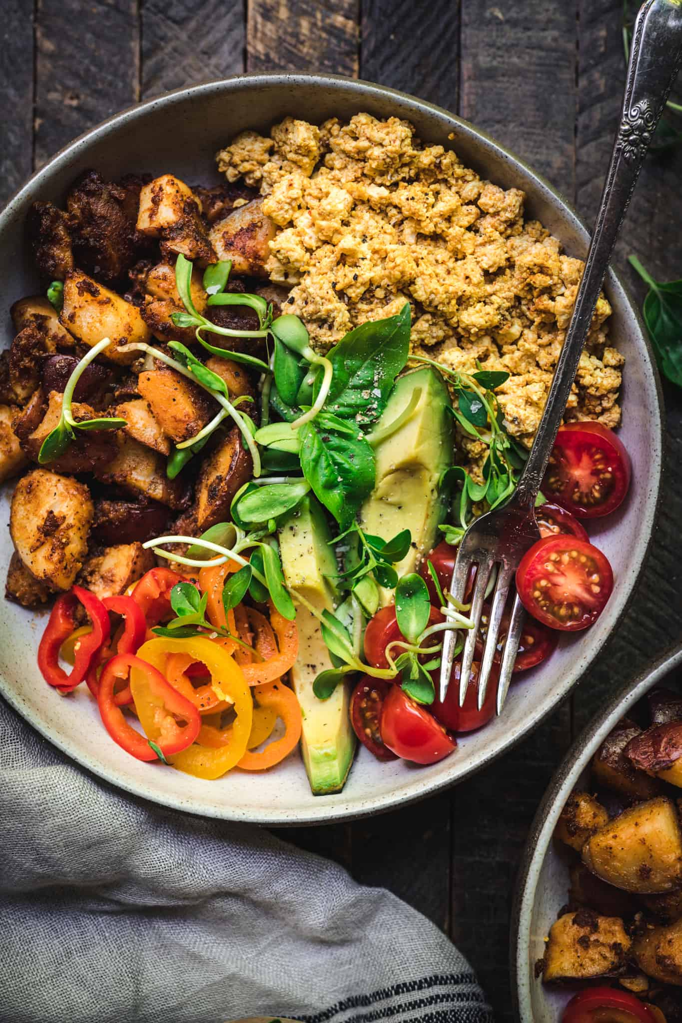 Overhead of vegan breakfast bowl with a fork