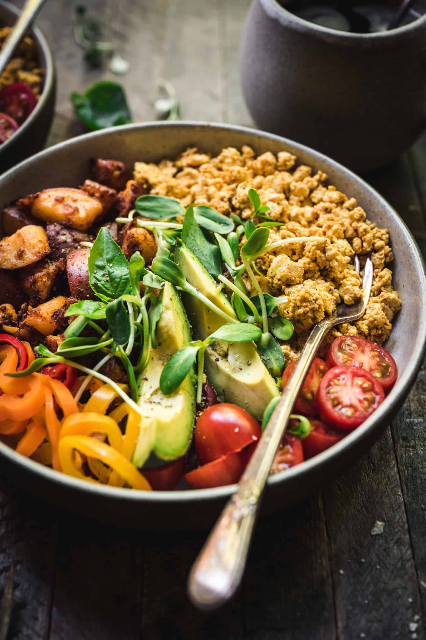 45 degree angle of high protein breakfast bowls with scrambled tofu and spicy potatoes