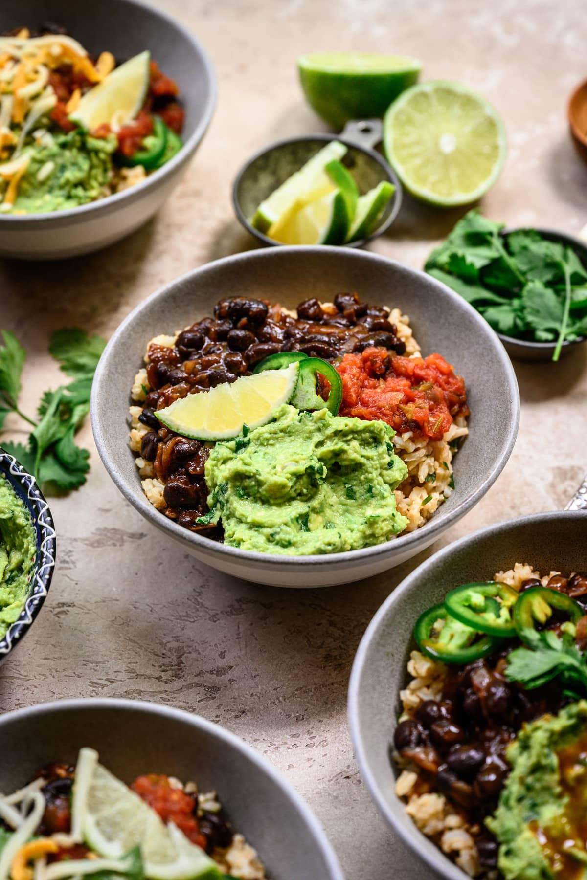 Side view of vegan burrito bowls with spicy black beans and guacamole