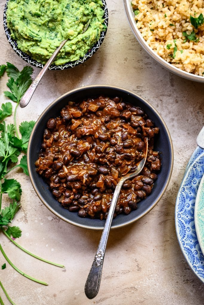 Overhead view of spicy vegan black beans in grey bowl