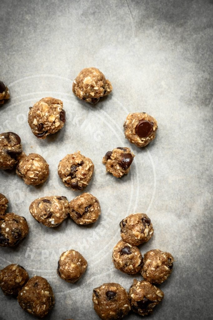 Overhead view of cookie dough bites on parchment paper