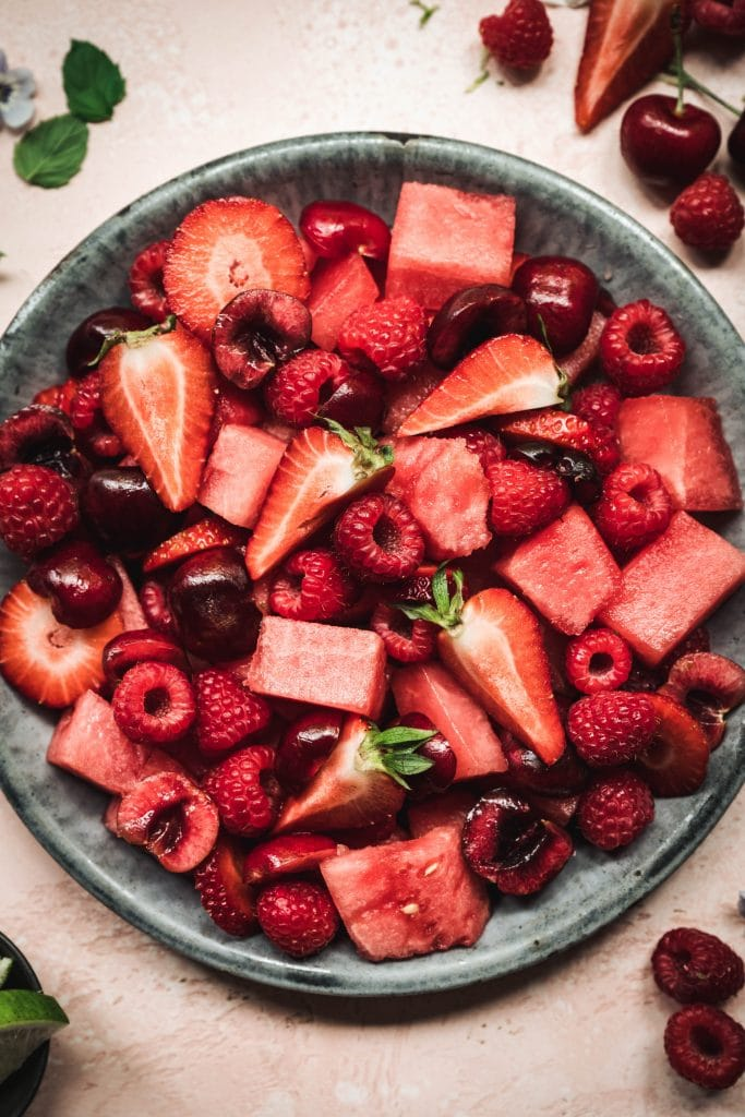 overhead of watermelon berry salad in a bowl