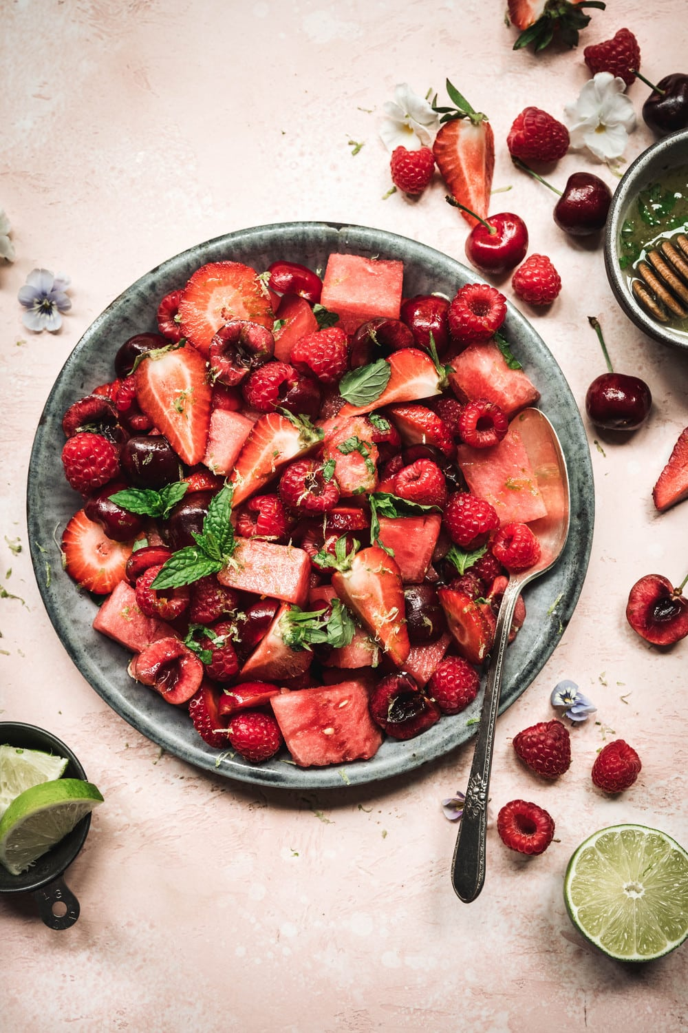 Watermelon berry salad with mint lime dressing in a bowl
