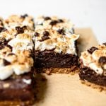 Side view of vegan and gluten free s'mores brownies on parchment paper