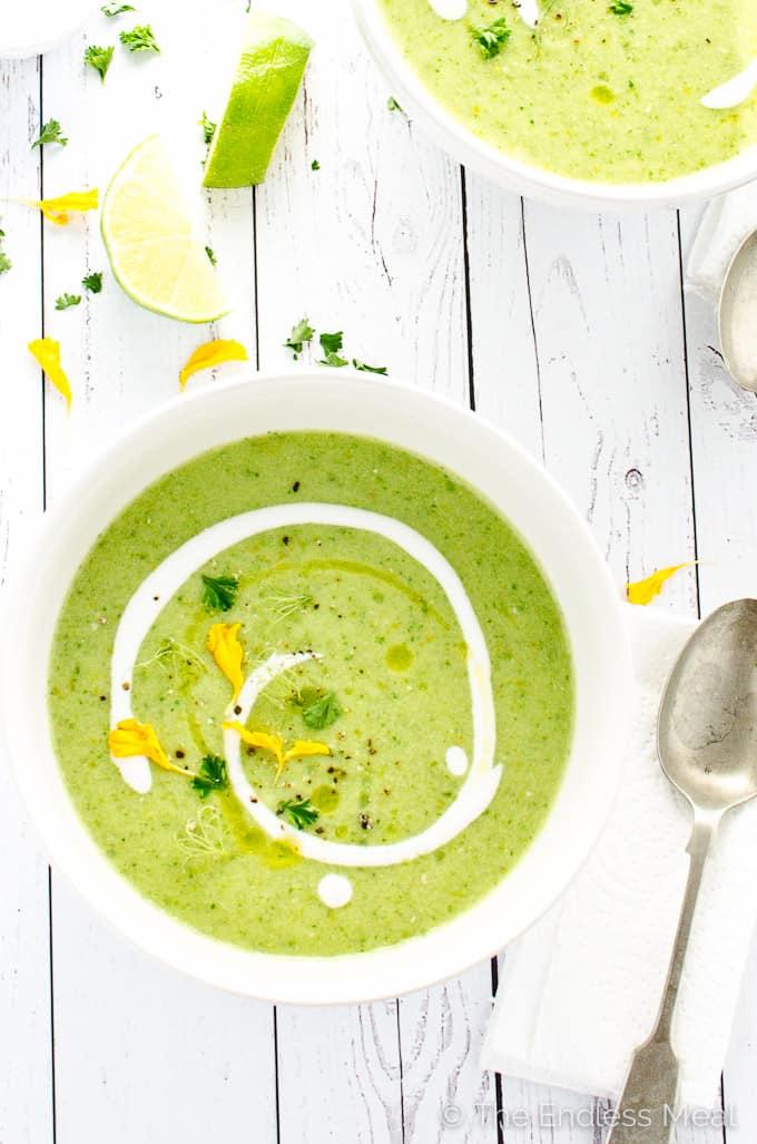 overhead of dairy free green gazpacho with vegan yogurt swirl