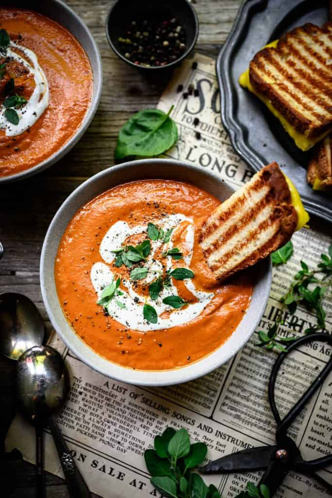 overhead of vegan tomato soup with grilled cheese