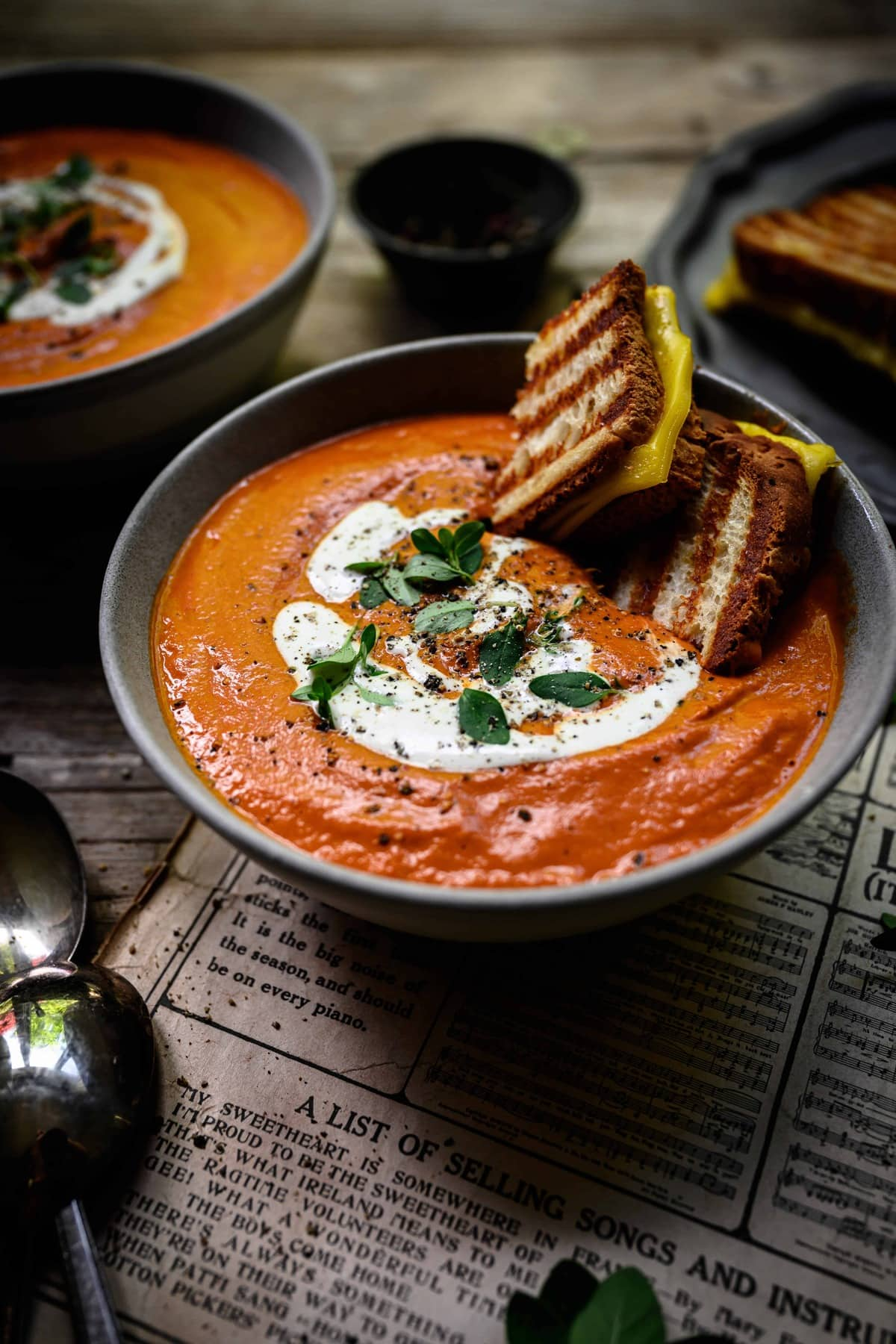 45 degree angle of roasted tomato soup with vegan grilled cheese