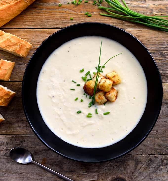 Overhead of chilled vegan vichyssoise potato leek soup