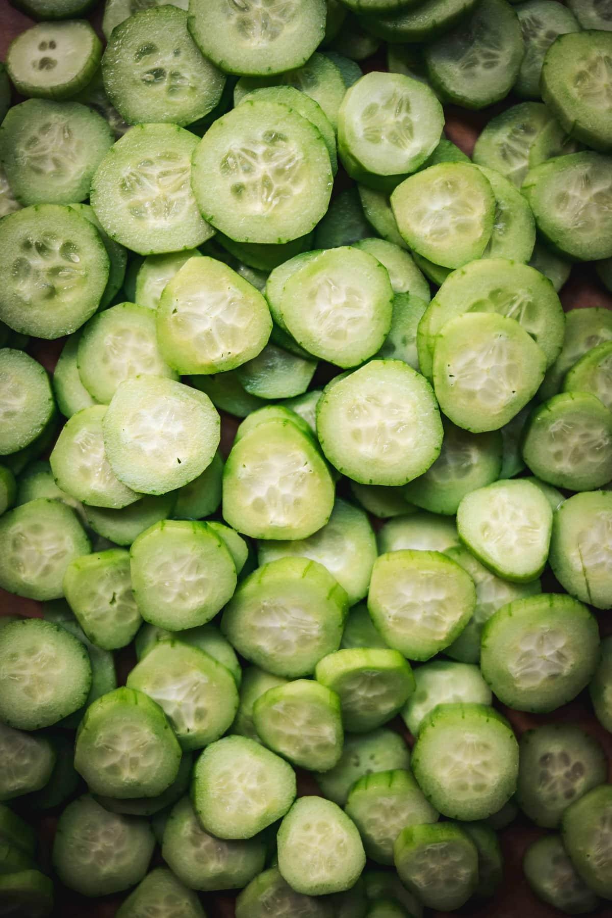 overhead of sliced, peeled cucumbers
