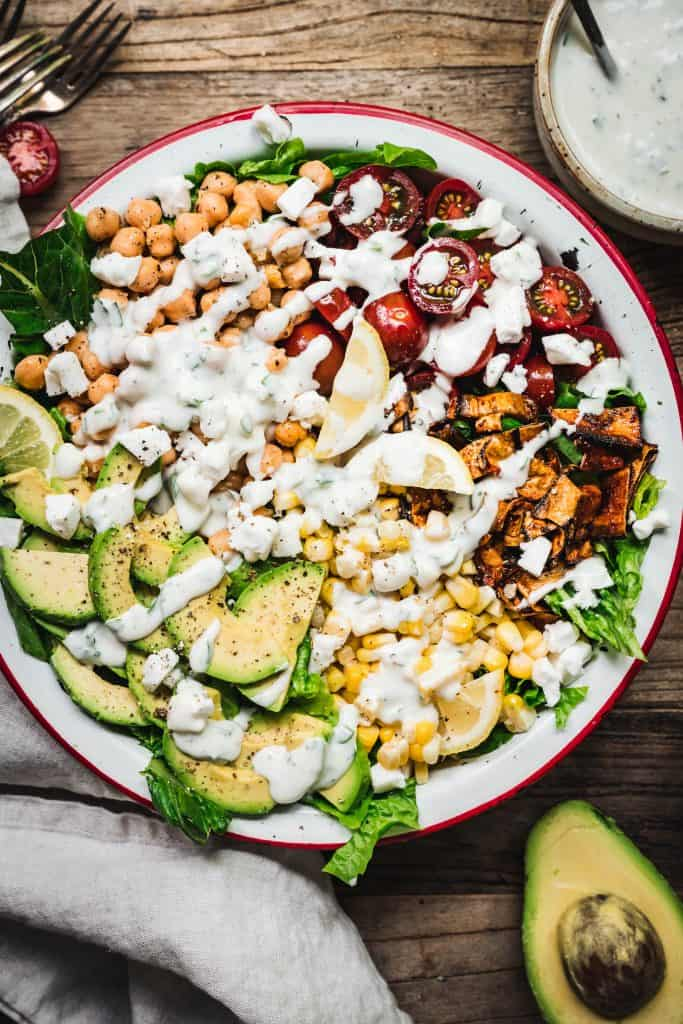 overhead of vegan cobb salad with crispy eggplant bacon and homemade ranch dressing