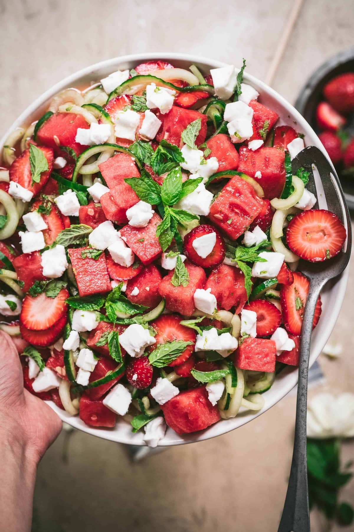 overhead of cucumber watermelon salad with feta