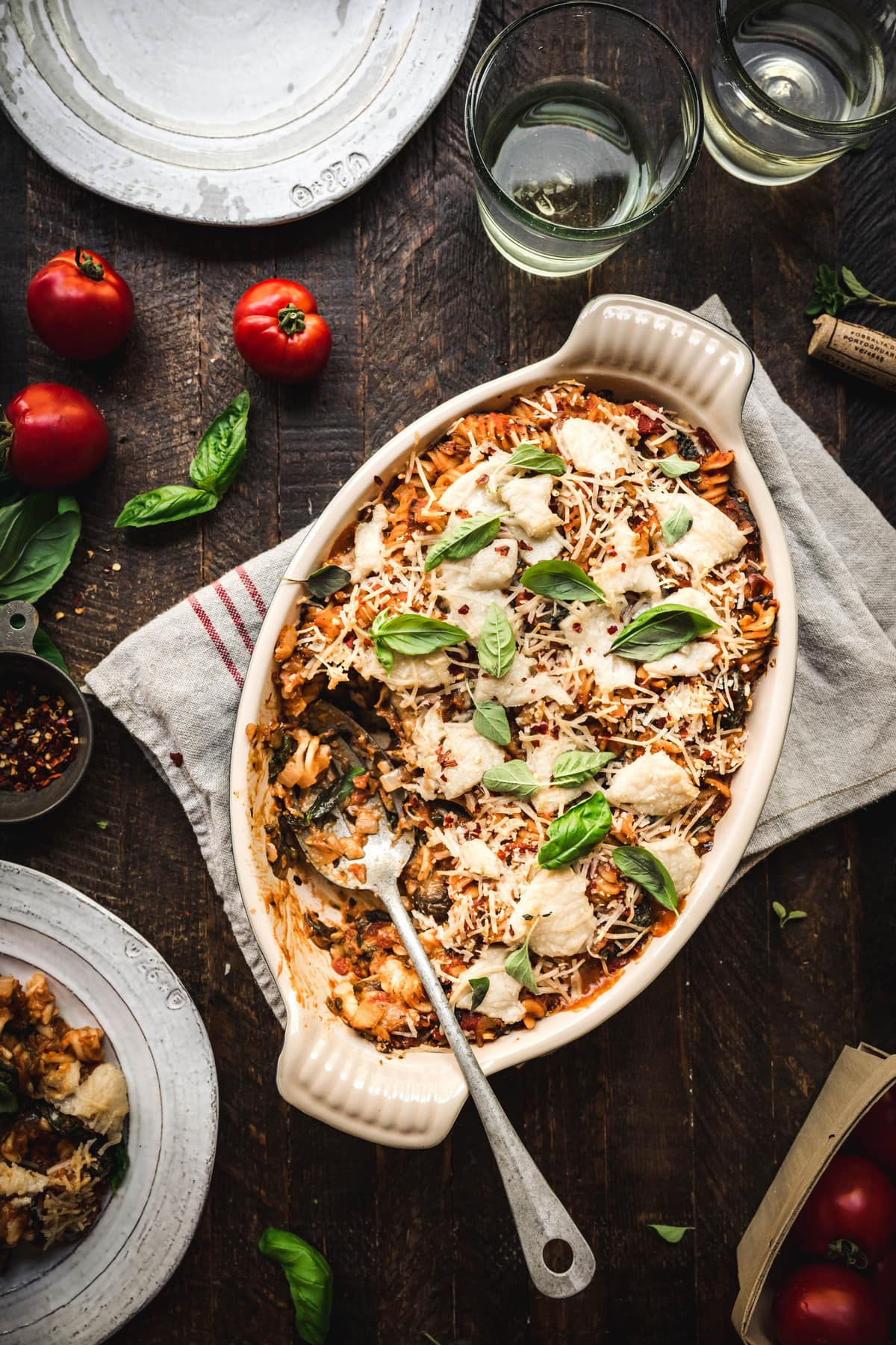 Overhead view of healthy vegan pasta bake on a rustic wood surface