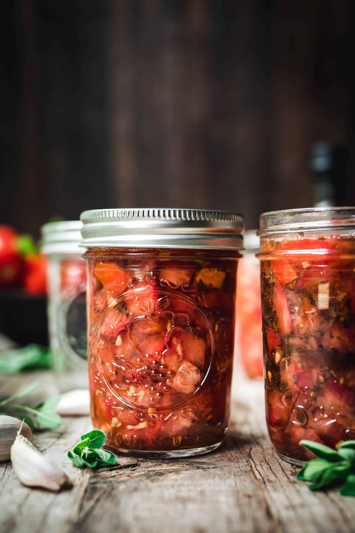 side view of tomato bruschetta in a jar