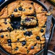 Overhead of gluten free blueberry cornbread in a skillet.