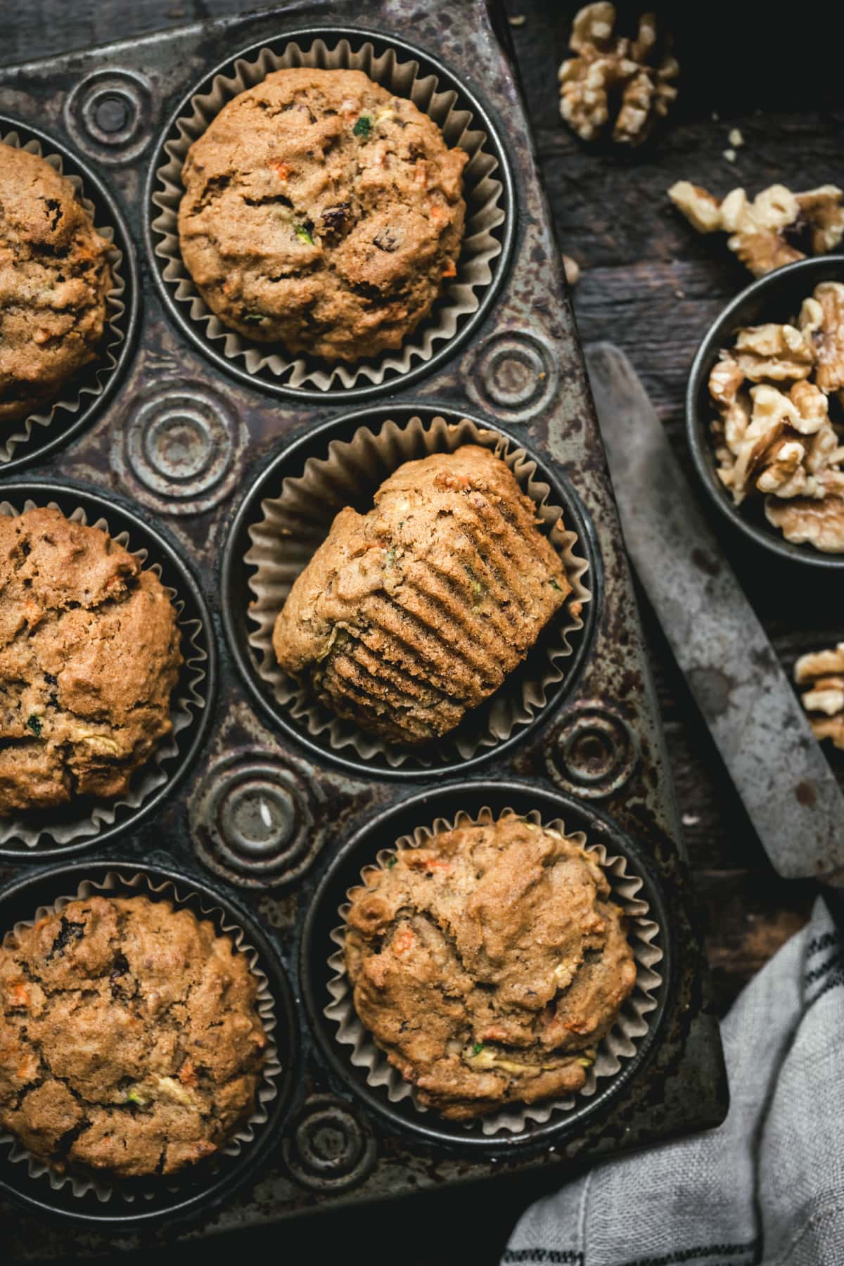 overhead of cooked vegan zucchini muffins in a muffin tin