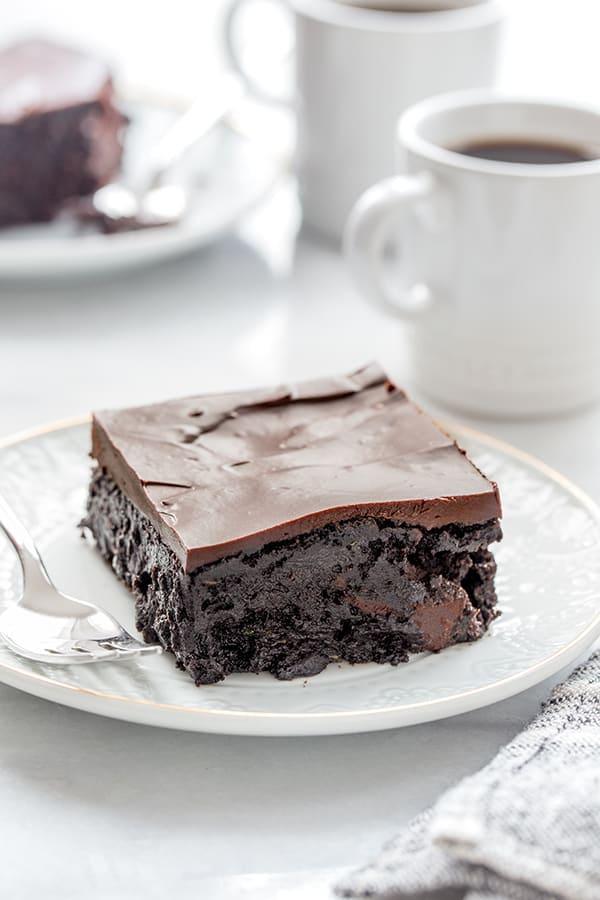side view of dense chocolate zucchini cake with homemade chocolate ganache