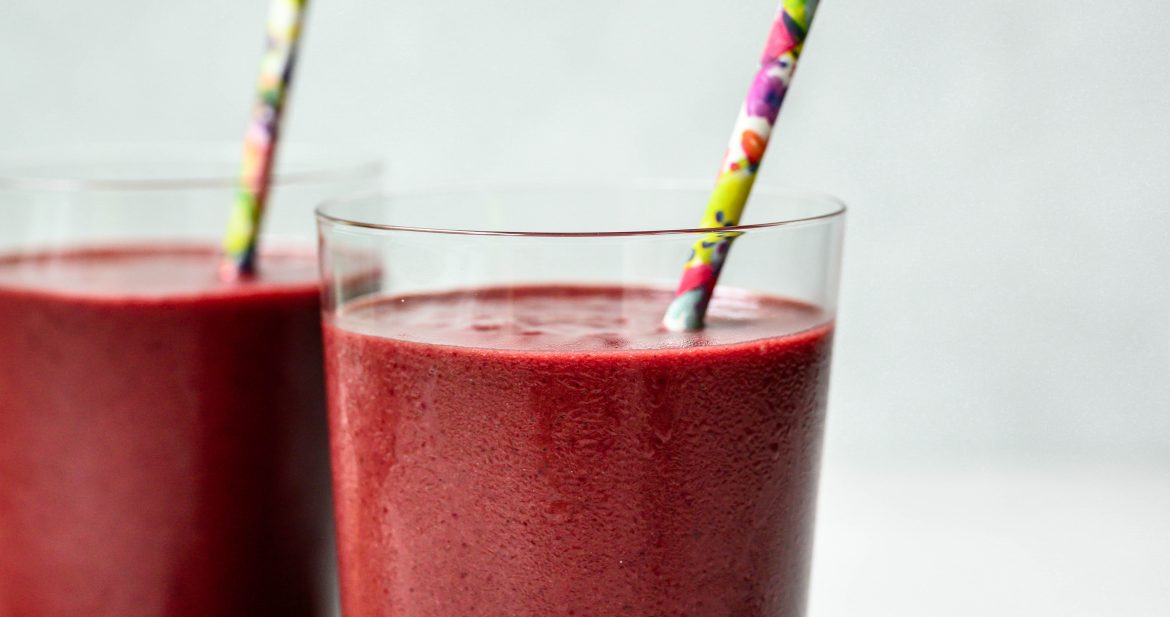side view of two glasses of tart cherry dark chocolate recovery smoothie